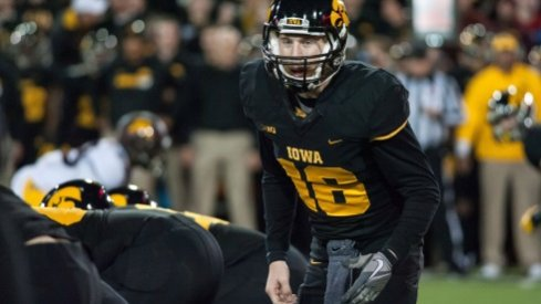 C.J. Beathard leads the Iowa Hawkeyes to the line of scrimmage against Minnesota