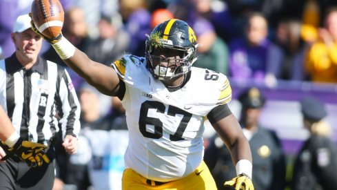 Jaleel Johnson recovers a fumble against Northwestern.