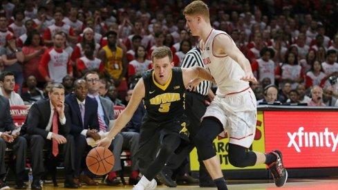 Iowa took advantage of a hot shooting night from distance and a slew of offensive rebounds to run Maryland out of their own gym.