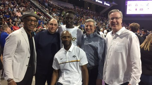 Peter Jok and his cadre of coaches after winning the 3-point contest.