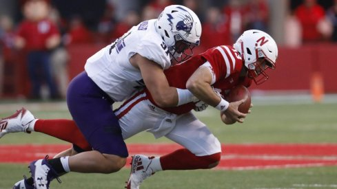 Nebraska quarterback Tanner Lee is totally not sacked, he meant to do that, dude.