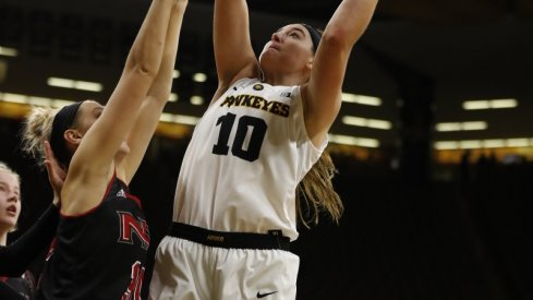 Megan Gustafson led Iowa with 22 points and 11 rebounds