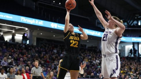 Iowa dominated 12-1 Northwestern on the road for a 77-51 win