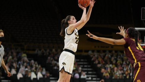 Caitlin Clark scored 37 points and grabbed 11 rebounds to lead Iowa over Minnesota