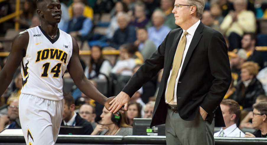 Peter Jok and Fran McCaffery, happy but also quietly plotting their revenge against UNO.