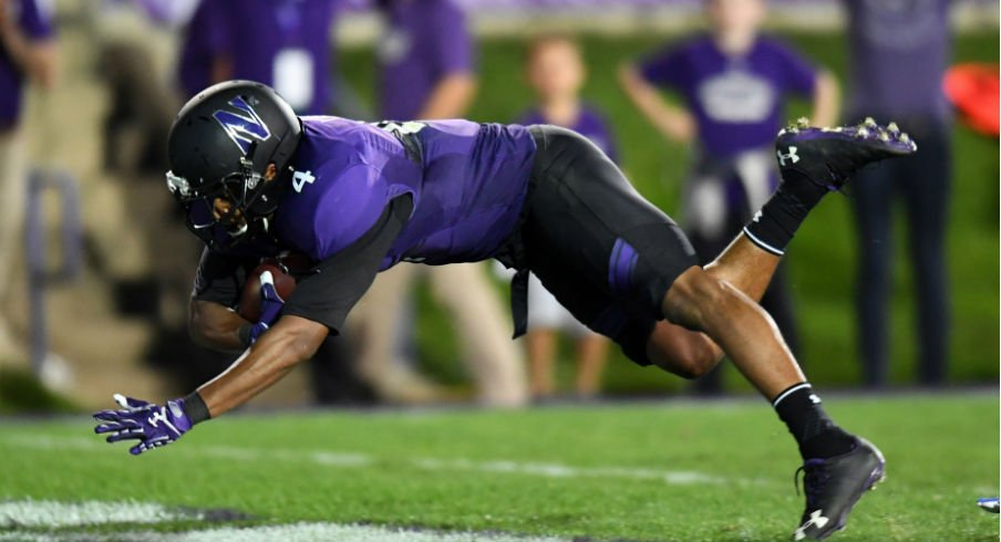 Iowa going to keep Northwestern from diving into the endzone like this.