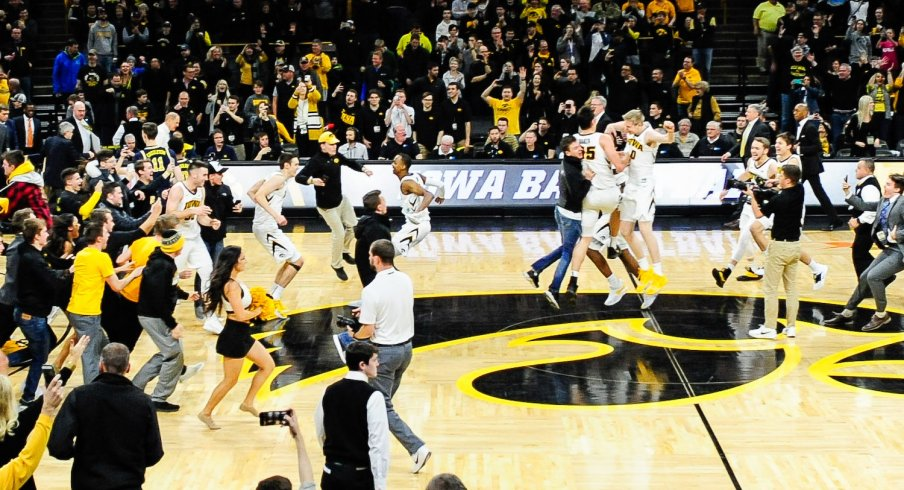 Iowa fans storm the court