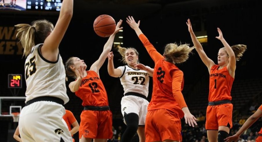 Kathleen Doyle led Iowa in a wild 77-75 overtime victory over Princeton