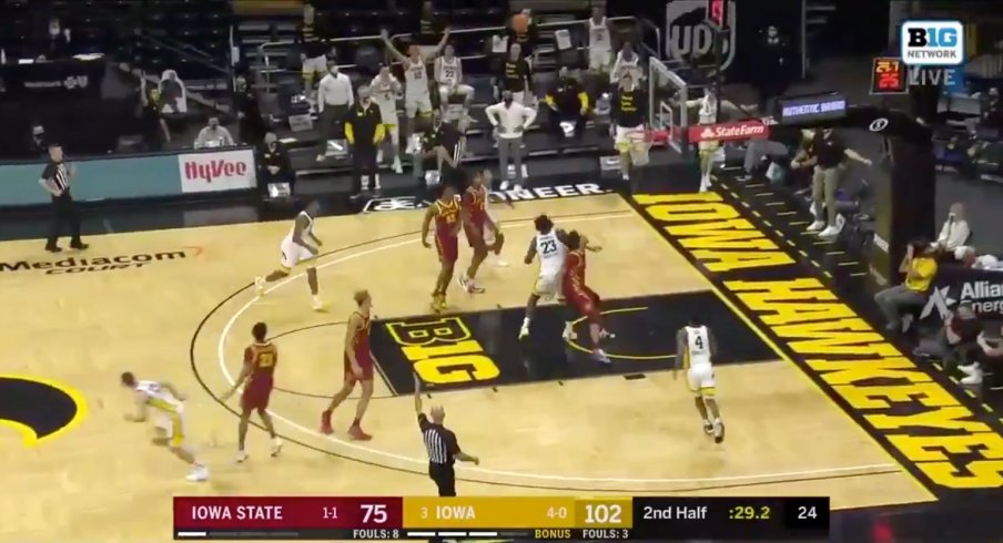 Austin Ash hoists a look-away 3 from deep and splashes it home